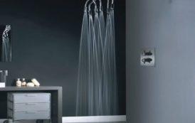 Moderno baño en dormitorio